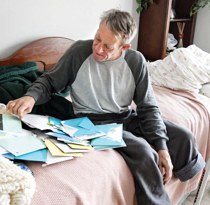 Kurt Kaser looks through some of the letters of support he has received at is home in rural Pender.